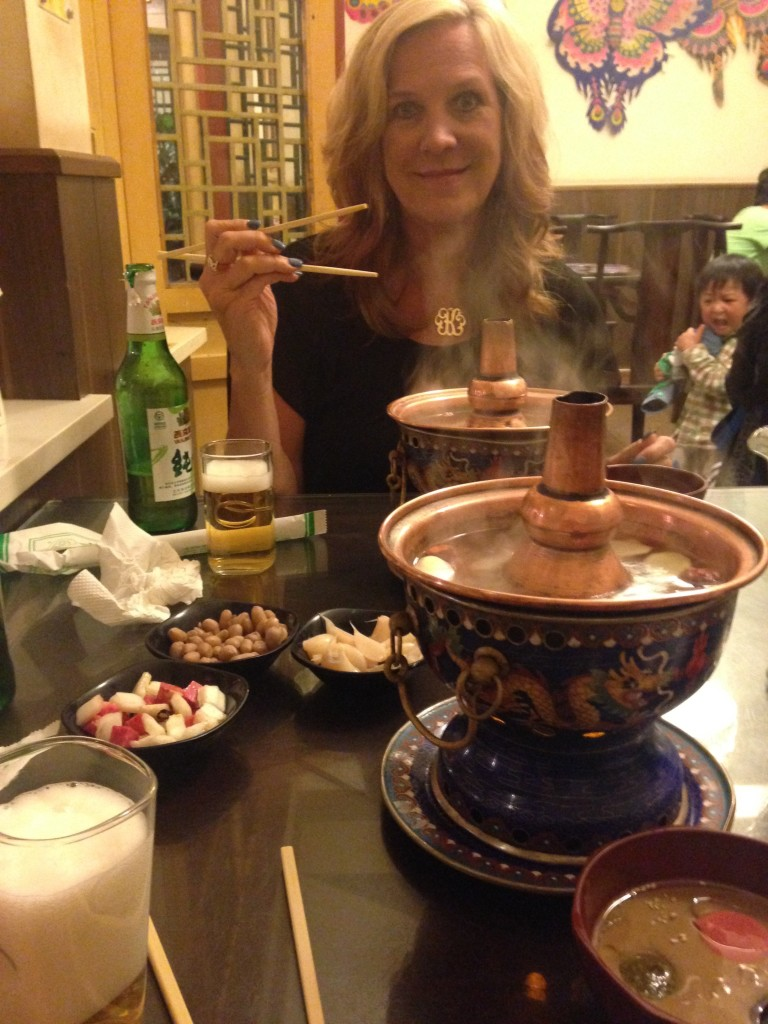 Mom trying a hot pot in Beijing.