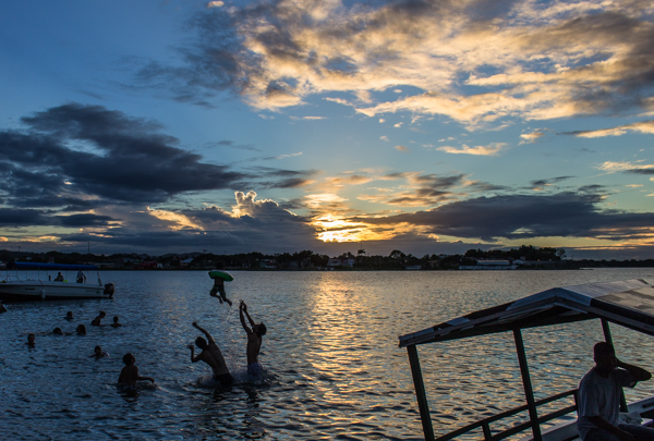 I somehow managed to catch a shot of some locals throwing a little boy into the air on Lago Petén Itzá just as the sun was setting.