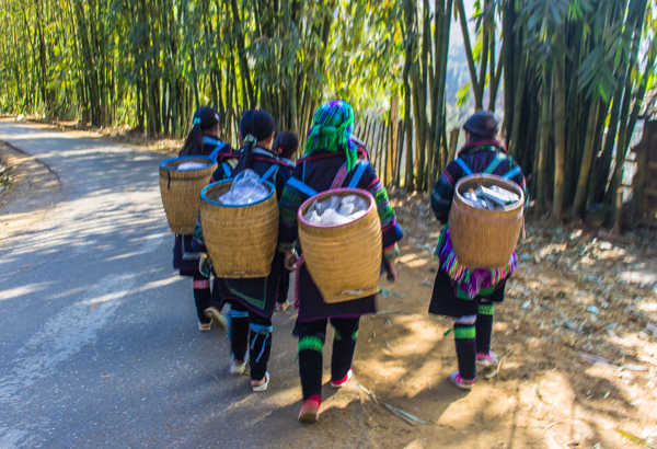 Following the lovely Hmong ladies to their village.