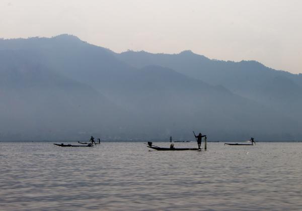 The fishermen really do have amazing balancing skills here.