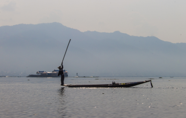 These fisherman also use a technique involving pounding the water with their oar to scare fish into their nets.